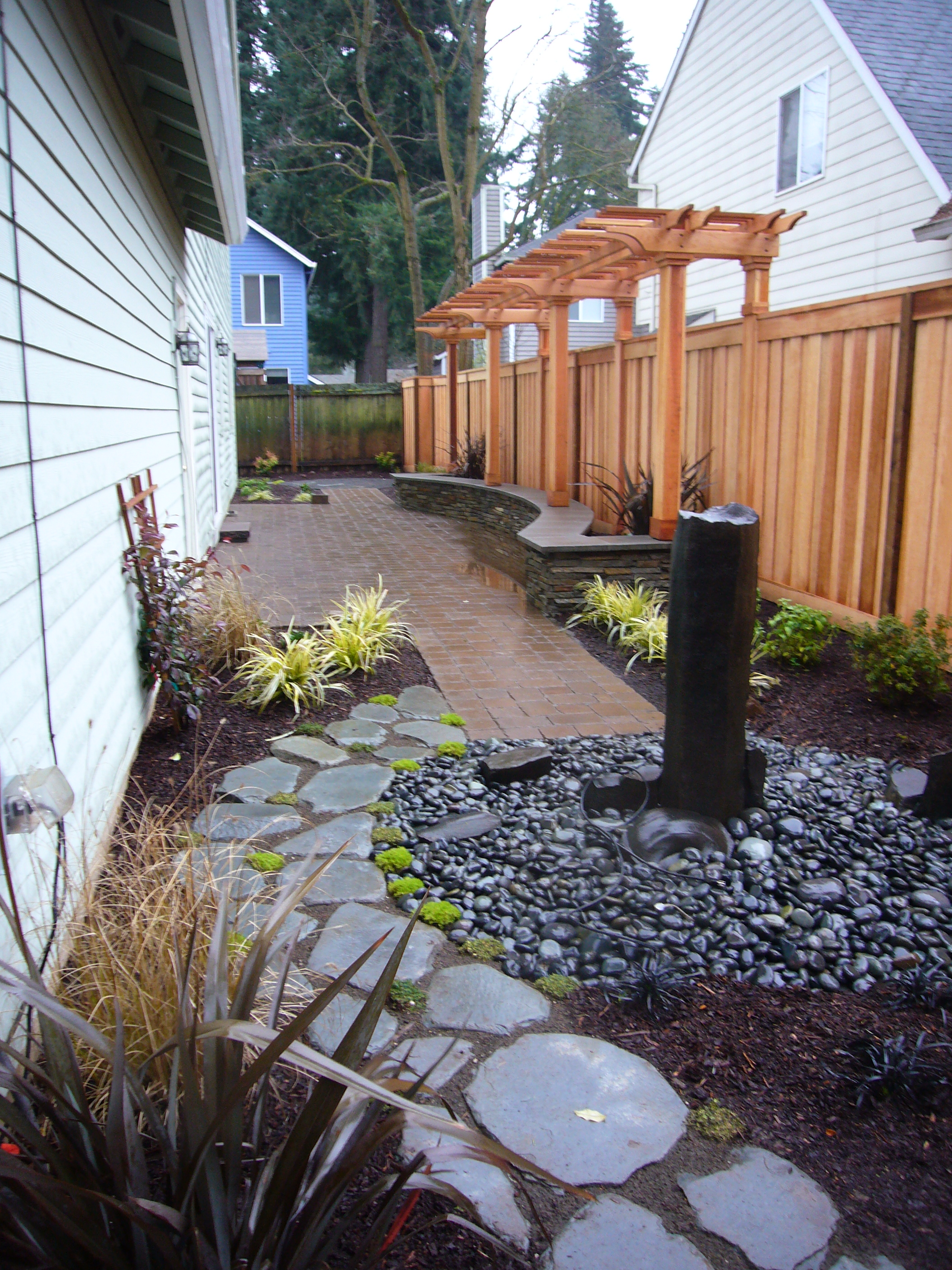 Res27-flagstone,path,waterfeature,riverrock,woodfence,pergola